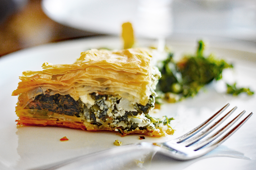 Slice of Spanakopita {Vegan} on a white plate