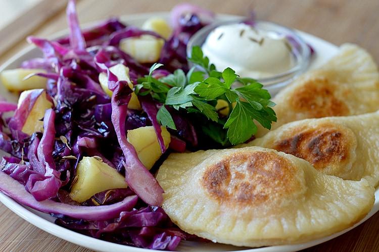 Sweet Potato & Caramelized Onion Pierogi With Sauteed Red Cabbage & Apples