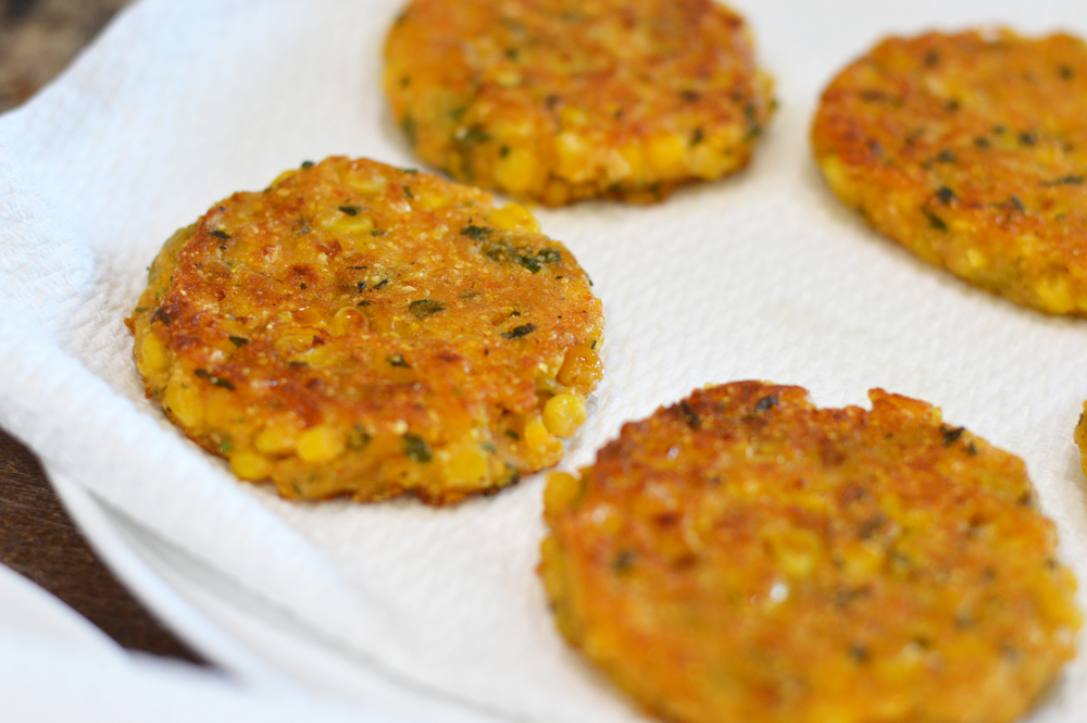 Draining Vegan Corn Fritters on Paper Towels