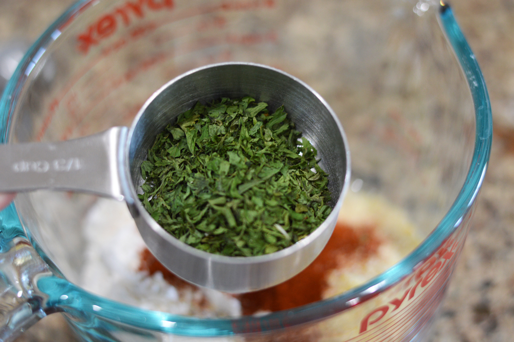 Measuring cup full of parsley for Measuring spoon full of salt for Vegan Corn Fritters