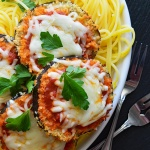Overhead view of vegan air fryer eggplant parmesan with spaghetti