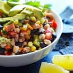 Photo of Cowboy Caviar a/k/a Texas Caviar with lemon wedges and avocado