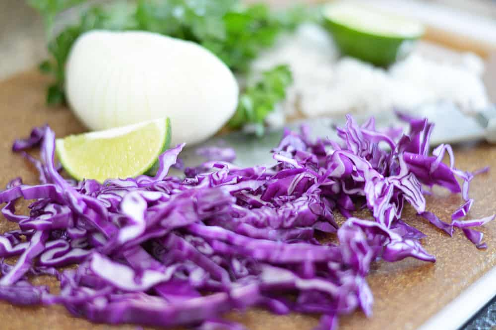 Chopping purple cabbage, white onions and parsley