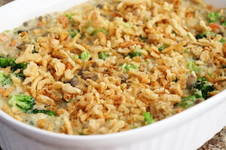 Adding fried onions to the top of the Creamy Vegan Broccoli Wild Rice Casserole