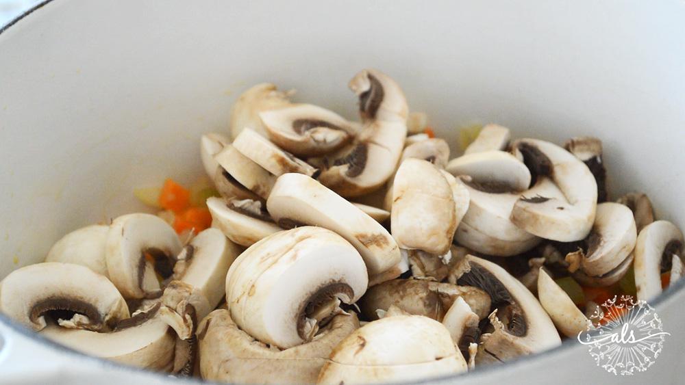 Adding sliced mushrooms to vegetables