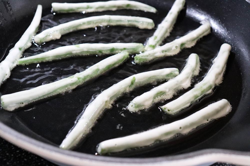 Pan frying battered green beans
