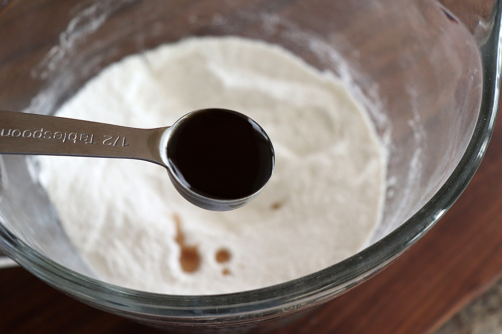 Vanilla extract in a measuring spoon for Easy Vegan Brownies