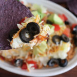 Bite from Easy Seven Layer Bean Dip