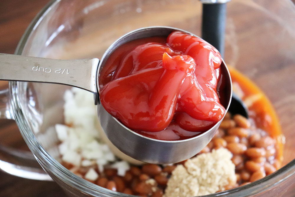 Adding ketchup to the beans