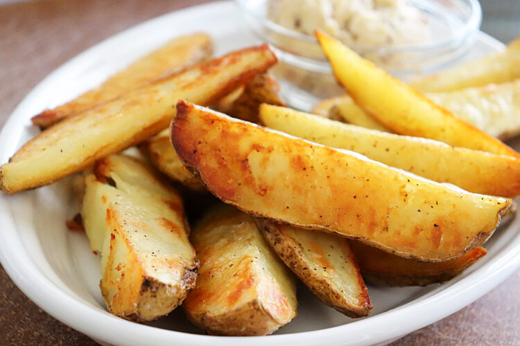 Hero Shot of Oven Roasted Potato Wedges with Vegan Mustard Butter