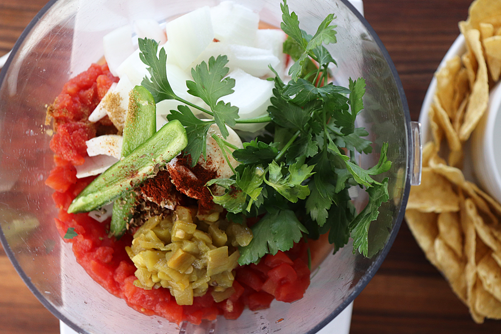 Ingredients for salsa in a food processor