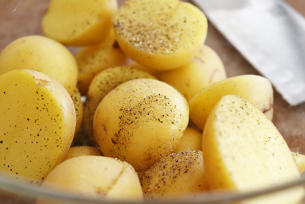 Seasoning the potatoes
